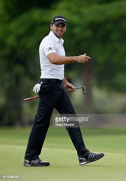 Jason Day of Australia reacts to his birdie putt on the 14th hole during a continuation of round three of the Zurich Classic of New Orleans at TPC...