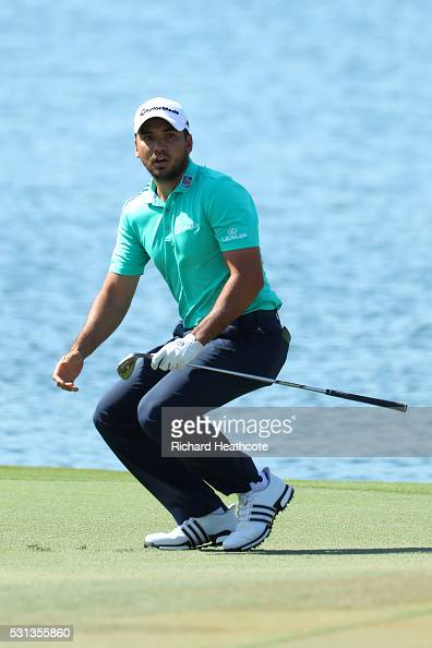 Jason Day of Australia reacts to nearly chipping in for birdie on the 18th during the resumption of the weather delayed second round of THE PLAYERS...