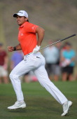 Jason Day of Australia runs on the first playoff hole semifinal match during the semifinal round of the World Golf Championships Accenture Match Play...