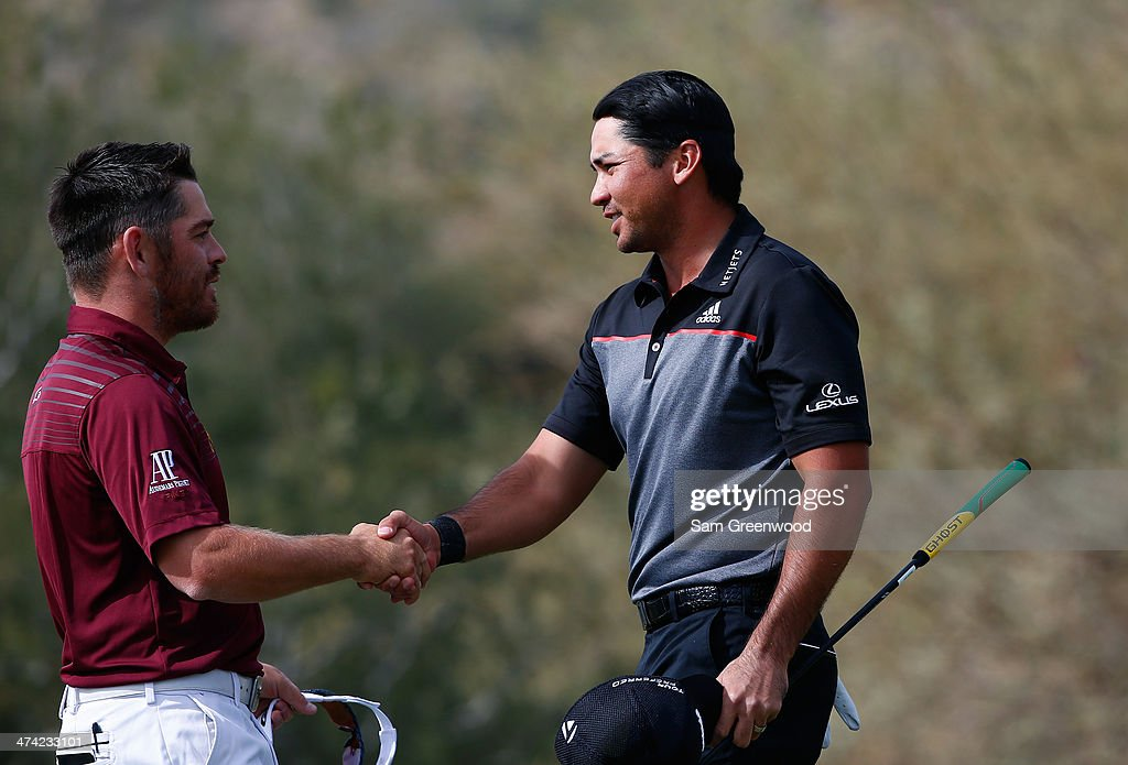 Jason Day of Australia (R) shakes hands with Louis Oosthuizen of South Africa after Day wins the match 2 and 1 during the quarterfinal round of the World Golf Championships - Accenture Match Play Championship at The Golf Club at Dove Mountain on February 22, 2014 in Marana, Arizona.