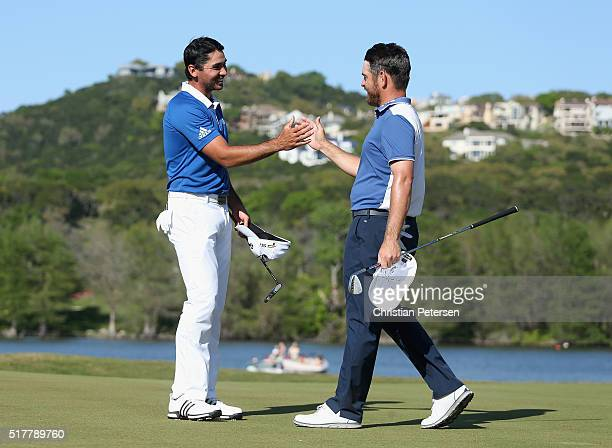 Jason Day of Australia shakes hands with Louis Oosthuizen of South Africa on the 14th green after Day defeated Oosthuizen 54 to win the championship...