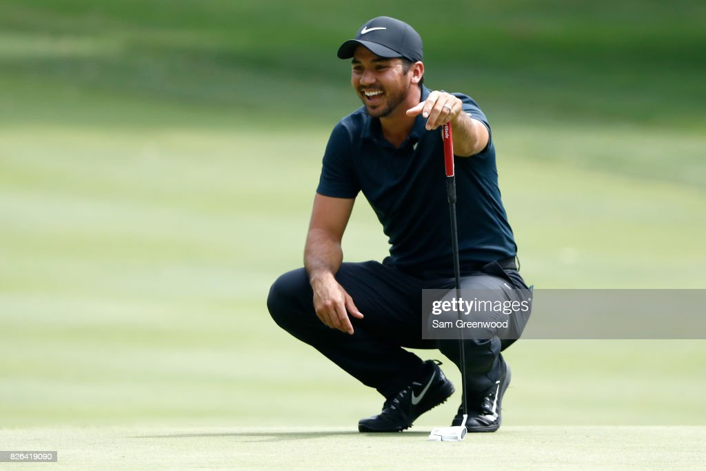 Jason Day of Australia smiles while lining up a putt on the sixth green during the second round of the World Golf Championships - Bridgestone Invitational at Firestone Country Club South Course on August 4, 2017 in Akron, Ohio.