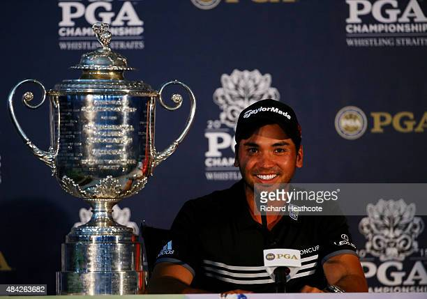 Jason Day of Australia speaks with the media alongside the Wanamaker Trophy after winning the 2015 PGA Championship with a score of 20under par at...