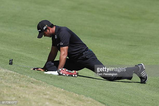 Jason Day of Australia stretches on the second fairway during the second round of the World Golf ChampionshipsDell Match Play at the Austin Country...
