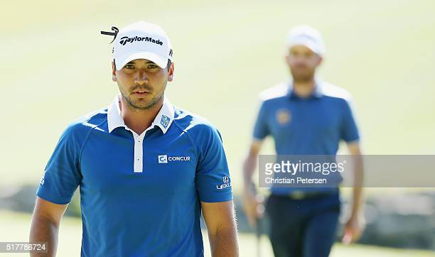 Jason Day of Australia strolls off the ninth green after a birdie putt during his match against Louis Oosthuizen of South Africa in the championship...