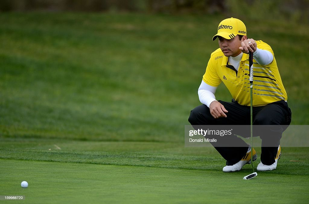 Jason Day of Australia studies the green during the First Round at the Farmers Insurance Open at Torrey Pines Golf Course on January 24, 2013 in La Jolla, California.