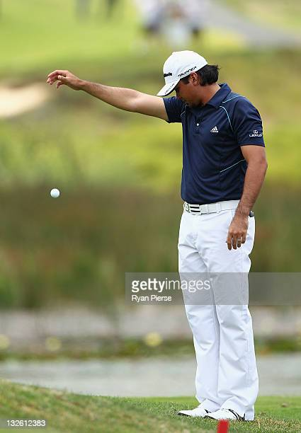 Jason Day of Australia takes a drop after hitting his tee shot into the lake on the 1st Hole during day four of the 2011 Emirates Australian Open at...