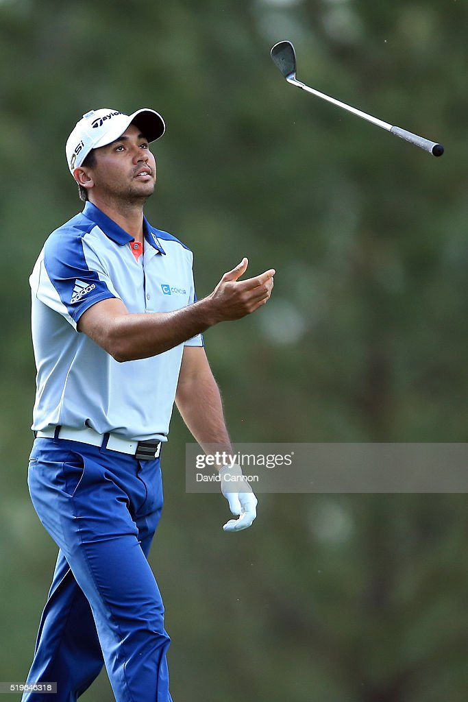 Jason Day of Australia tosses his club in the air after playing his second shot on the 14th hole during the first round of the 2016 Masters...