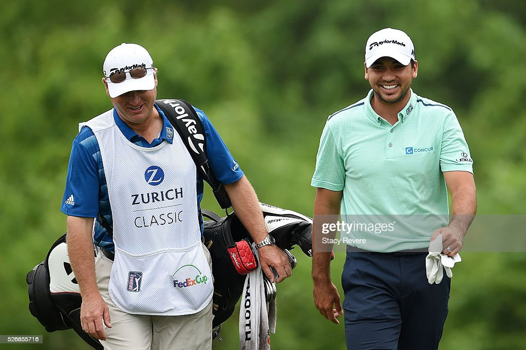 Jason Day of Australia walks down the second fairway with his caddie during a continuation of the third round of the Zurich Classic at TPC Louisiana on May 1, 2016 in Avondale, Louisiana.