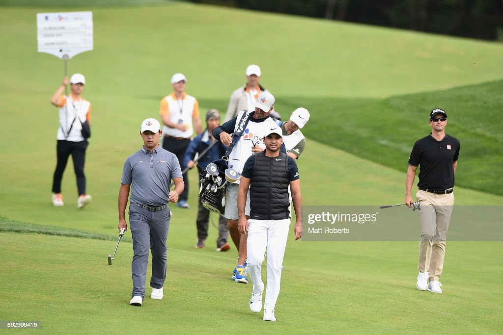 Jason Day (C) of Australia walks the 6th hole fairway during the first round of the CJ Cup at Nine Bridges on October 19, 2017 in Jeju, South Korea.
