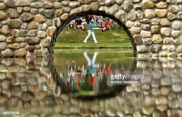 Jason Day of Australia walks to the third hole during the final round of the World Golf Championships Bridgestone Invitational at Firestone Country...