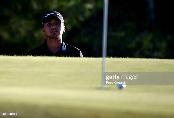 Jason Day of Australia watches his fourth shot on the 18th green during round two of the Deutsche Bank Championship at TPC Boston on September 5 2015...