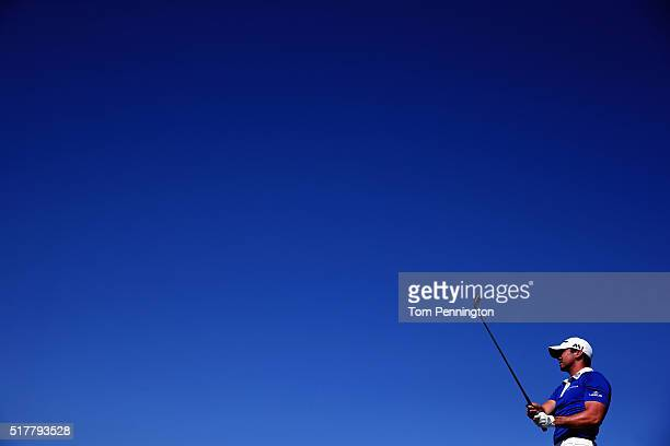 Jason Day of Australia watches his tee shot on the 11th hole during his match against Louis Oosthuizen of South Africa in the championship match of...