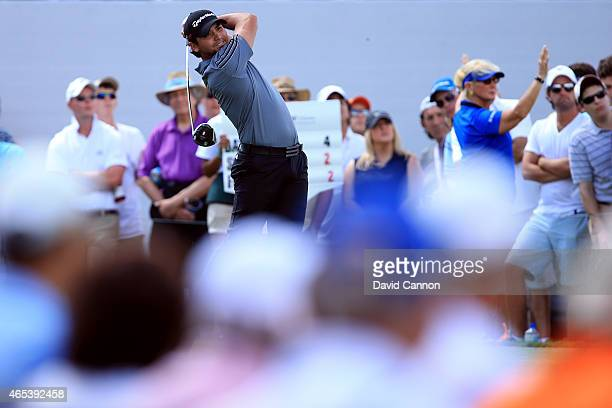 Jason Day of Australia watches his tee shot on the tenth hole during the second round of the World Golf ChampionshipsCadillac Championship at Trump...