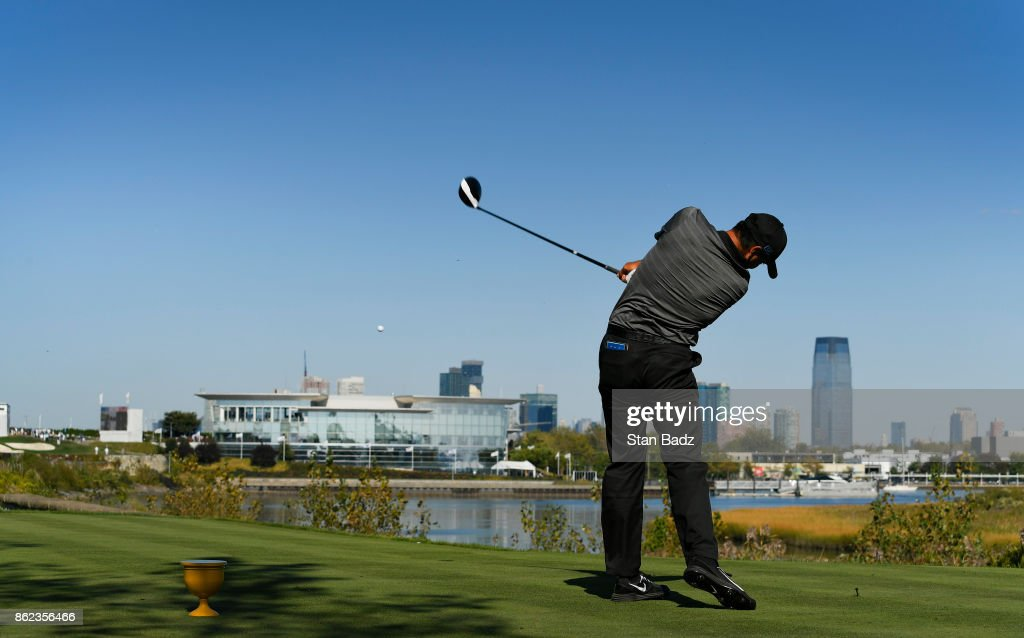 Jason Day of the International Team hits a drive on the 14th hole during the Sunday singles matches at the Presidents Cup at Liberty National Golf Club on October 1, 2017, in Jersey City, New Jersey.
