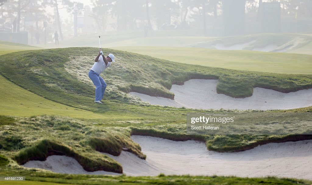 Jason Day of the International team plays a shot from the rough during a practice round prior to the start of The Presidents Cup at the Jack Nicklaus Golf Club on October 7, 2015 in Incheon City, South Korea.
