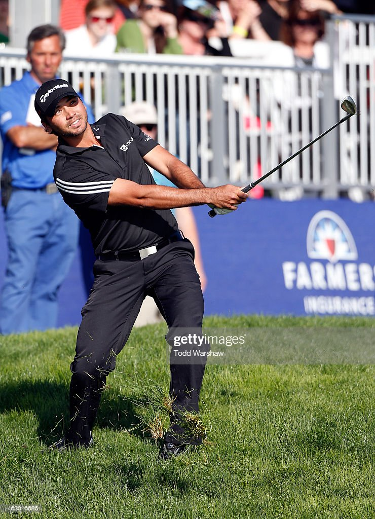 Jason Day plays a shot from the rough on the 18th hole during the final round of the Farmers Insurance Open at Torrey Pines South on February 8, 2015 in La Jolla, California.