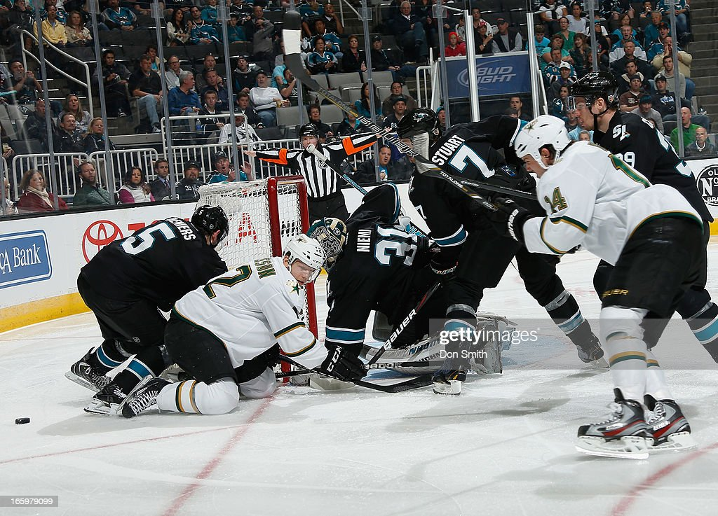 Jason Demers #5, Brad Stuart #7, Logan Couture #39 and Antti Niemi #31 of the San Jose Sharks defend the net against Alex Chiasson #12 and Jamie Benn #14 of the Dallas Stars during an NHL game on April 7, 2013 at HP Pavilion in San Jose, California.