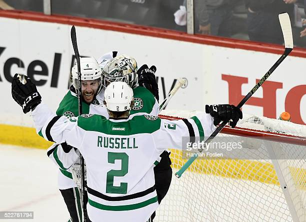 Jason Demers goalie Antti Niemi and Kris Russell of the Dallas Stars celebrate a win against the Minnesota Wild of Game Four of the Western...