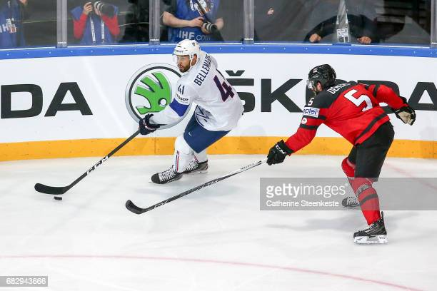 Jason Demers of Canada challenges Pierre Edouard Bellemare of France during the 2017 IIHF Ice Hockey World Championship game between Canada and...