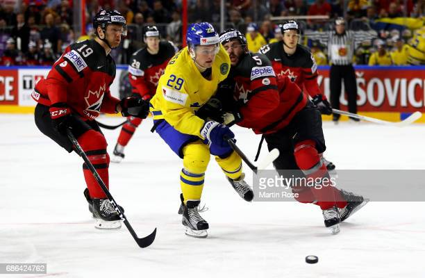 Jason Demers of Canada challenges William Nylander of Sweden for the puck during the 2017 IIHF Ice Hockey World Championship Gold Medal game Canada...