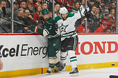 Jason Demers of the Dallas Stars defends Chris Porter of the Minnesota Wild in Game Four of the Western Conference First Round during the 2016 NHL...