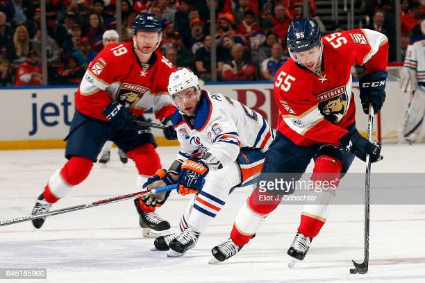 Jason Demers of the Florida Panthers skates with the puck against Iiro Pakarinen of the Edmonton Oilers at the BBT Center on February 22 2017 in...