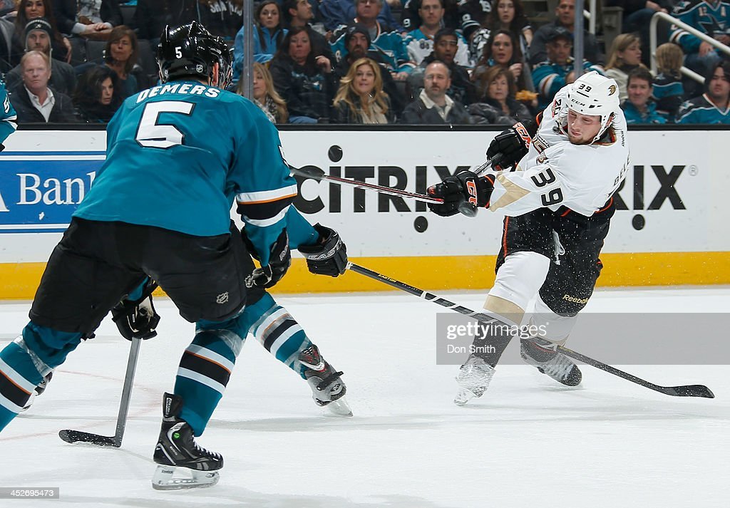 <a gi-track='captionPersonalityLinkClicked' href=/galleries/search?phrase=Jason+Demers&family=editorial&specificpeople=2282534 ng-click='$event.stopPropagation()'>Jason Demers</a> #5 of the San Jose Sharks gets in front of a shot against <a gi-track='captionPersonalityLinkClicked' href=/galleries/search?phrase=Matt+Beleskey&family=editorial&specificpeople=570471 ng-click='$event.stopPropagation()'>Matt Beleskey</a> #39 of the Anaheim Ducks during an NHL game on November 30, 2013 at SAP Center in San Jose, California.