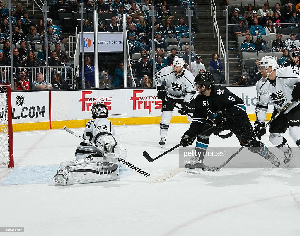 <a gi-track='captionPersonalityLinkClicked' href=/galleries/search?phrase=Jason+Demers&family=editorial&specificpeople=2282534 ng-click='$event.stopPropagation()'>Jason Demers</a> #5 of the San Jose Sharks takes a shot against <a gi-track='captionPersonalityLinkClicked' href=/galleries/search?phrase=Jonathan+Quick&family=editorial&specificpeople=2271852 ng-click='$event.stopPropagation()'>Jonathan Quick</a> #32 of the Los Angeles Kings in Game Five of the First Round of the 2014 Stanley Cup Playoffs at SAP Center on April 26, 2014 in San Jose, California.