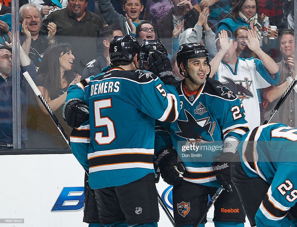 Jason Demers #5, Scott Gomez #23 and Martin Havlat #9 of the San Jose Sharks celebrate Havlat's goal against the Nashville Predators during an NHL game on February 2, 2013 at HP Pavilion in San Jose, California.