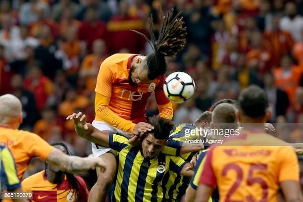 Jason Denayer of Galatasaray in action against Nabil Dirar of Fenerbahce during a Turkish Super Lig match between Galatasaray and Fenerbahce at Ali...
