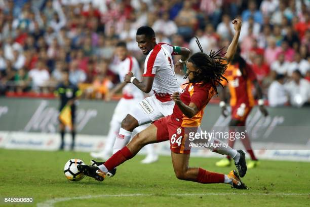 Jason Denayer of Galatasaray in action against Samuel Etoo of Antalyaspor during the 4th week of the Turkish Super Lig match between Antalyaspor and...