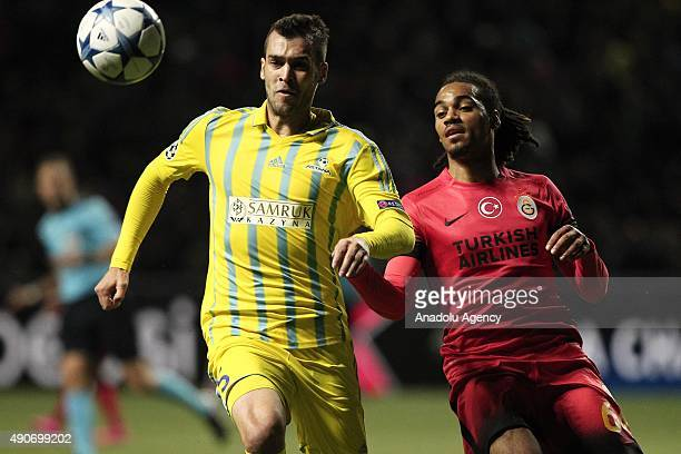Jason Denayer of Galatasaray vies for the ball with Marin Anicic of Astana during the UEFA Champions League Group C football match between FC Astana...