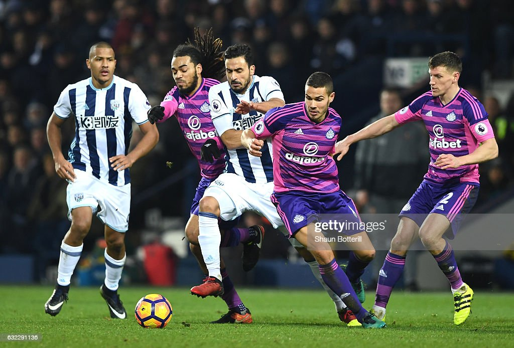 Jason Denayer of Sunderland (L) and Jack Rodwell of Sunderland (R) attempt to stop Nacer Chadli of West Bromwich Albion (C) during the Premier League match between West Bromwich Albion and Sunderland at The Hawthorns on January 21, 2017 in West Bromwich, England.