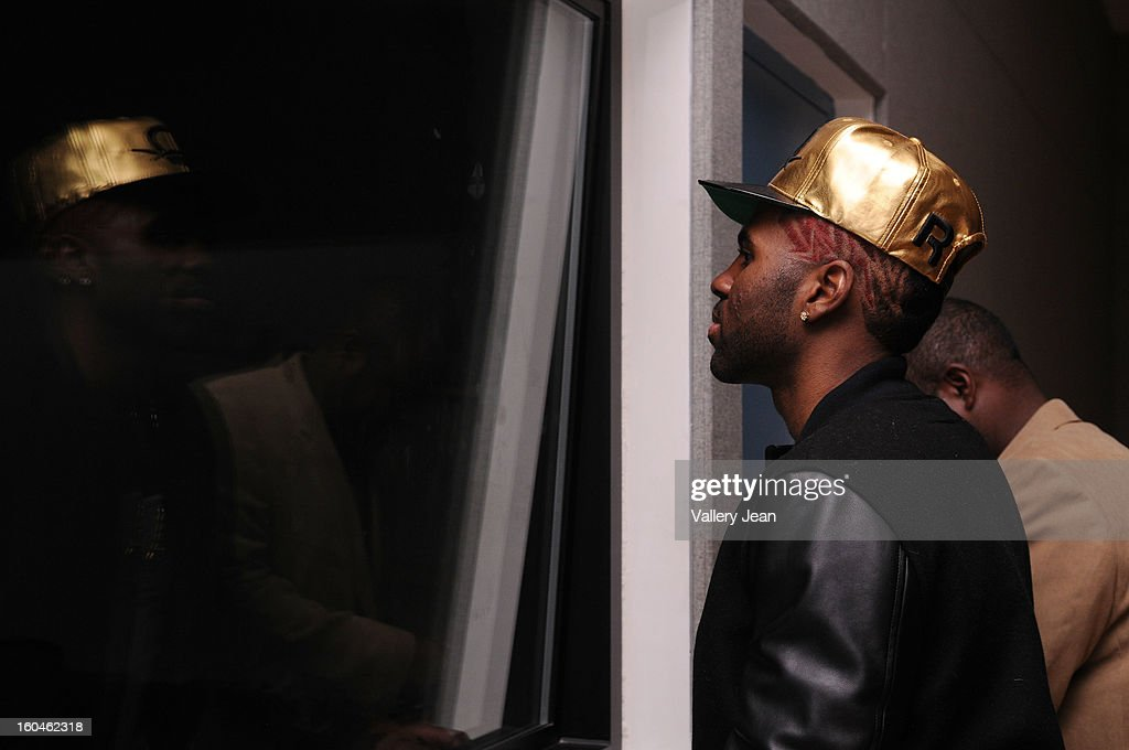 <a gi-track='captionPersonalityLinkClicked' href=/galleries/search?phrase=Jason+Derulo&family=editorial&specificpeople=5745869 ng-click='$event.stopPropagation()'>Jason Derulo</a> watching the student Talent Show at the production booth at William H. Turner Technical Arts High School on January 31, 2013 in Miami, Florida.