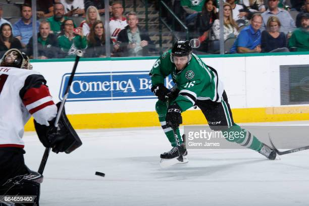 Jason Dickinson of the Dallas Stars blasts a shot on goal against the Arizona Coyotes at the American Airlines Center on April 4 2017 in Dallas Texas