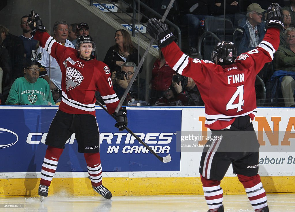 <a gi-track='captionPersonalityLinkClicked' href=/galleries/search?phrase=Jason+Dickinson&family=editorial&specificpeople=10032437 ng-click='$event.stopPropagation()'>Jason Dickinson</a> #11 of the Guelph Storm celebrates a goal against the London Knights in Game Six of the 2014 MasterCard Memorial Cup at Budweiser Gardens on May 21, 2014 in London, Ontario, Canada. The Storm defeated the Knights 7-2.