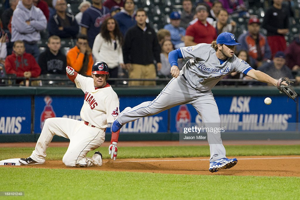 Jason Donald #16 is safe at second off a single by Michael Brantley #23 of the Cleveland Indians as third baseman <a gi-track='captionPersonalityLinkClicked' href=/galleries/search?phrase=Mike+Moustakas&family=editorial&specificpeople=6780077 ng-click='$event.stopPropagation()'>Mike Moustakas</a> #8 of the Kansas City Royals can't make the catch during the eighth inning at Progressive Field on September 29, 2012 in Cleveland, Ohio.