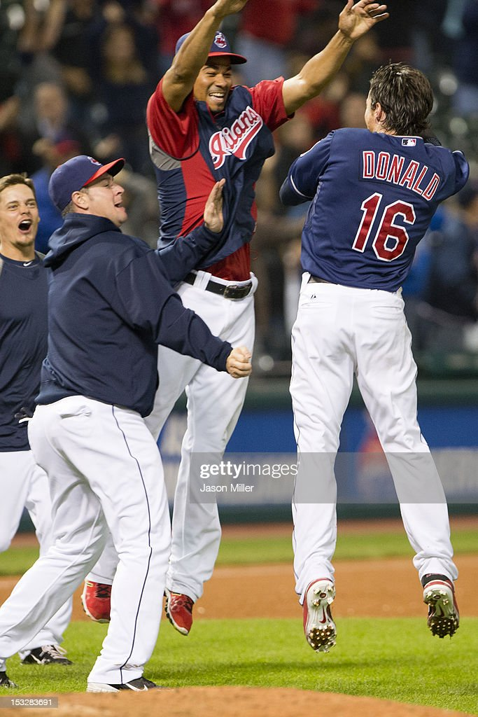 Jason Donald #16 of the Cleveland Indians celebrates with teammates after hitting a walk-off single during the twelfth inning against the Chicago White Sox at Progressive Field on October 2, 2012 in Cleveland, Ohio. The Indians defeated the White Sox 4-3.