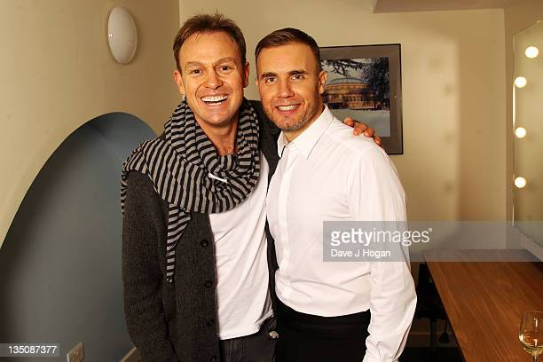 LR Jason Donovan and Gary Barlow pose backstage after performing onstage for the Prince's Trust at The Royal Albert Hall on December 5 2011 in London...