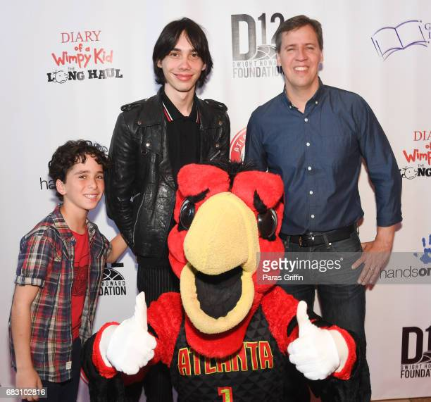 Jason Drucker Charlie Wright and Jeff Kinney pose with Harry The Hawk at 'Diary Of A Wimpy Kid The Long Haul' Atlanta screening hosted by Dwight...