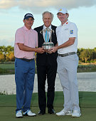 Jason Dufner and Brandt Snedeker pose with Greg Norman and the trophy after winning the Franklin Templeton Shootout at Tiburon Golf Club on December...