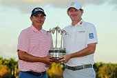 Jason Dufner and Brandt Snedeker pose with the trophy after winning the Franklin Templeton Shootout at Tiburon Golf Club on December 12 2015 in...