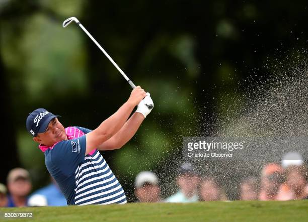 Jason Dufner drives his ball form a sand trap along the 10th fairway during second round action of the PGA Championship at Quail Hollow Club Friday...