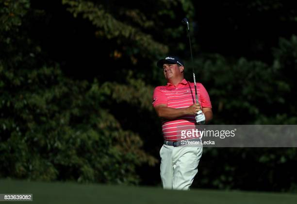 Jason Dufner hits a shot on the 13th hole during the first round of the Wyndham Championship at Sedgefield Country Club on August 17 2017 in...