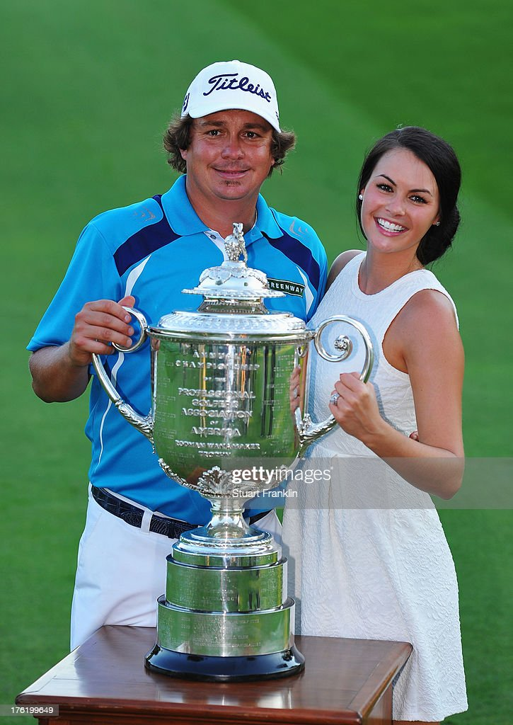 <a gi-track='captionPersonalityLinkClicked' href=/galleries/search?phrase=Jason+Dufner&family=editorial&specificpeople=561651 ng-click='$event.stopPropagation()'>Jason Dufner</a> of the United States and his wife Amanda pose with the Wanamaker tophy after his two-stroke victory at the 95th PGA Championship at Oak Hill Country Club on August 11, 2013 in Rochester, New York.