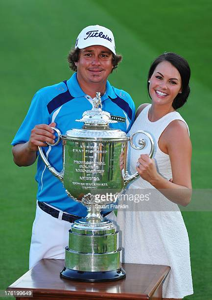 Jason Dufner of the United States and his wife Amanda pose with the Wanamaker tophy after his twostroke victory at the 95th PGA Championship at Oak...