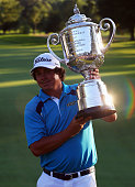 Jason Dufner of the United States celebrates with the Wanamaker Trophy after his twostroke victory at the 95th PGA Championship at Oak Hill Country...