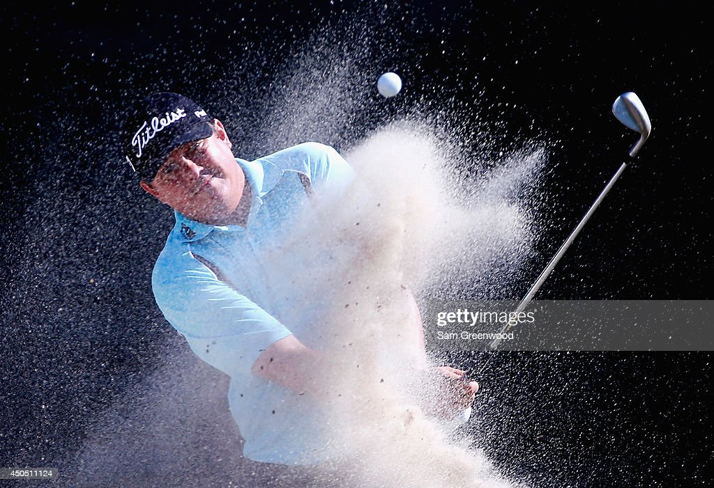 <a gi-track='captionPersonalityLinkClicked' href=/galleries/search?phrase=Jason+Dufner&family=editorial&specificpeople=561651 ng-click='$event.stopPropagation()'>Jason Dufner</a> of the United States hits a shot from a bunker on the 12th hole during the first round of the 114th U.S. Open at Pinehurst Resort & Country Club, Course No. 2 on June 12, 2014 in Pinehurst, North Carolina.