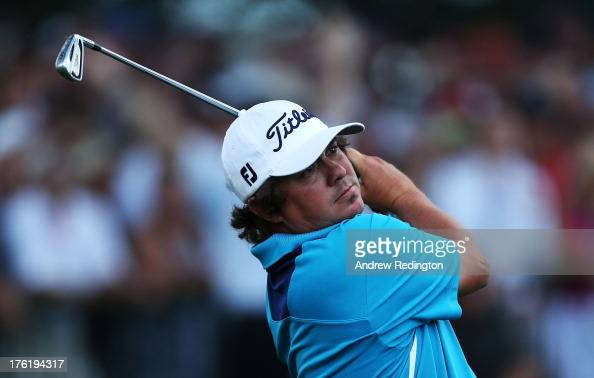 Jason Dufner of the United States hits his tee shot on the 14th hole during the final round of the 95th PGA Championship at Oak Hill Country Club on...